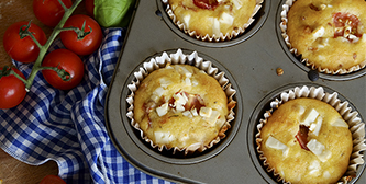 Corn muffins with feta and tomatoes